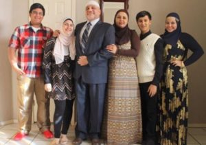 Imam Enchassi and his family. You can tell they're terrorists because his wife and daughters dress modestly, and he wears a funny hat.