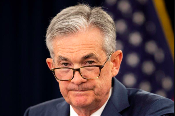 The Fed Slashes Rates as Powell Declares Economy 'Strong'