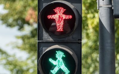 Traffic Lights, Risk Assessment, and Social Distancing in a COVID-19 World