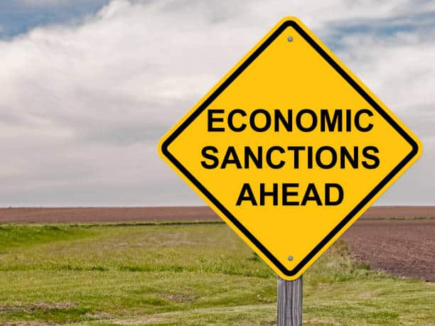 sign warning that economic sanctions are ahead