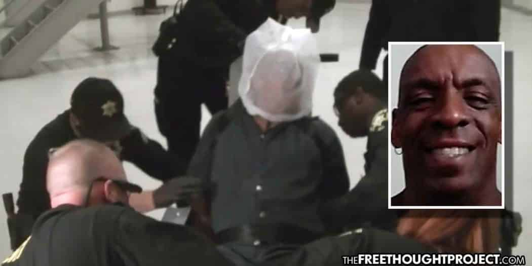 Watch: Cops Sit on Man Having a Seizure Until He Dies (Taxpayers To Foot Bill)